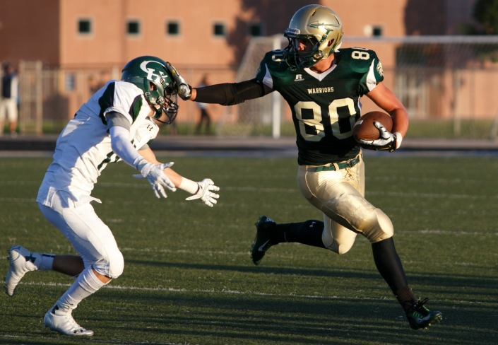 Snow Canyon tight end Chance Thorkelson carries the ball Friday, Aug. 22, 2014.