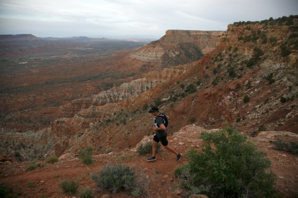 Clouds loom in the sky above as a runner makes his way along the Flying Monkey Trail above Virgin early Friday, April 8, 2016 during the Zion 100 ultra marathon trail race. Runners competing in the 100K and 100 mile distances left the starting line Friday morning while runners competing in 55K and half-marathon distances will start Saturday morning. Despite a high probability of rain over the weekend, nearly 300 runners took of from the starting line Friday morning and more than another 200 were expected to run Saturday.