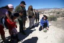 Elaine York, right, the West Desert Regional Director for the Nature Conservancy, leads a tour Saturday, April 23, 2016 of the Nature Conservancy's new White Dome Nature Preserve, one of just five places on earth where the endangered dwarf bear poppy grows. The preserve is open to the public and features several miles of hiking trails where visitors can see the endangered plant.