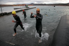 Ironman 70.3 St. George participants reach the transition area between the swim and bike portions of the course as they leave the waters of Sand Hollow Reservoir behind and begin to strip off their wetsuits Saturday, May 7, 2016.